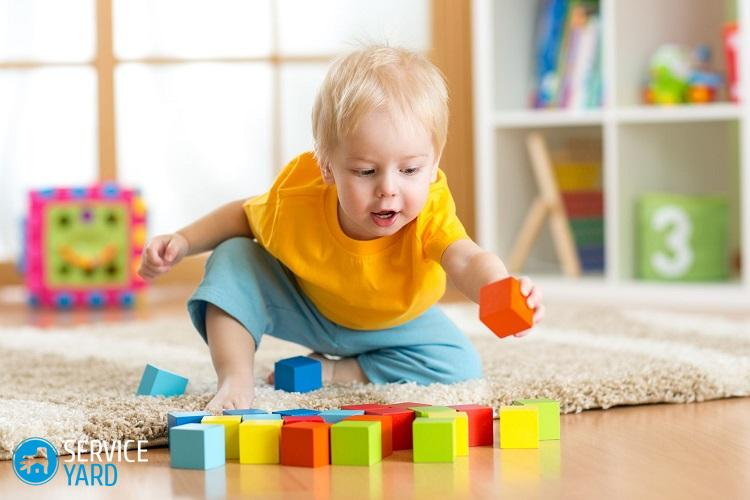 35418140 - child toddler playing wooden toys at home or kindergarten